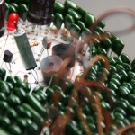 Big circuit board with green capacitors